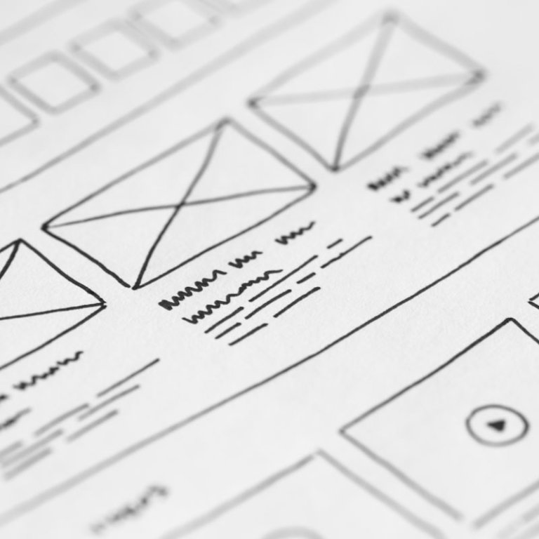 UX/UI web design on paper